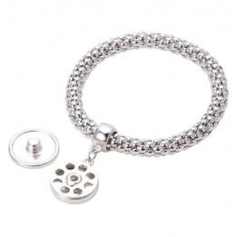 Bracelet métallique argenté avec pendentif rond Ø 18 mm