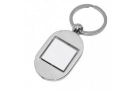 Porte-clé ovale 8,3 x 3,1 cm en métal argenté avec carré rotatif